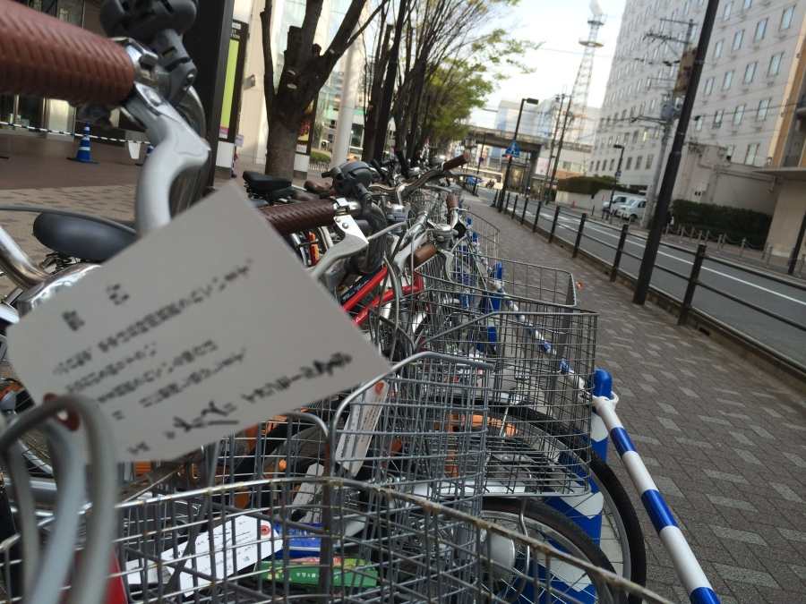 Bicycle valet parking in front of a shopping mall in downtown Kyoto