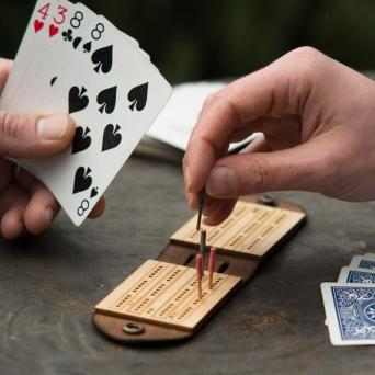 Our popular leather Travel Cribbage Board is a perfect gift for cribbage-playing groomsmen.