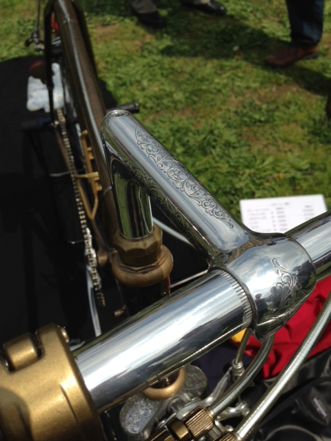Metal filigree chosen to look like John Wayne's pistol on the bicycle handlebars