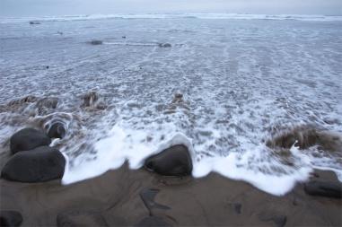 Sea foam and the rising tide