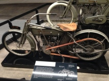 Vintage Harley dressed in saddle tan leather, even the belt drive.