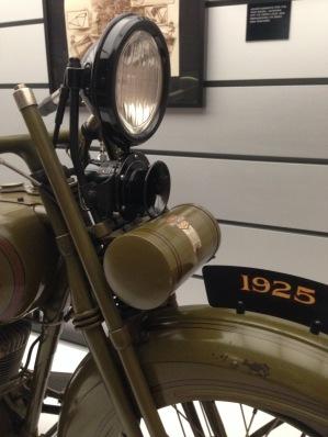 1925 vintage Harley with a barrel shaped handlebar bag.