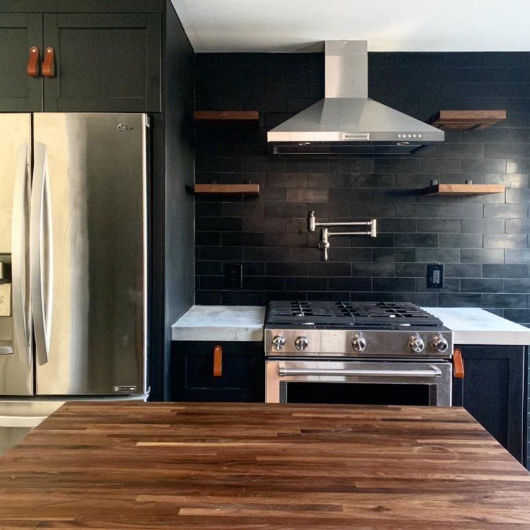A gorgeous kitchen with leather drawer pulls
