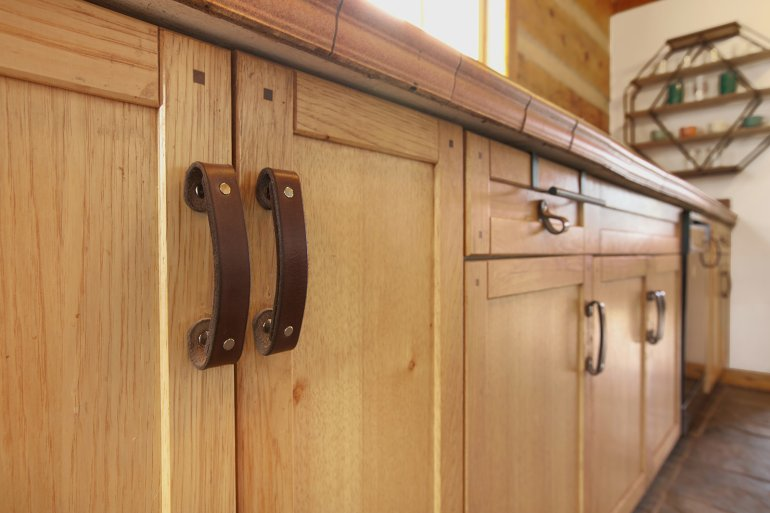 Leather drawer pulls freshen up old cabinets
